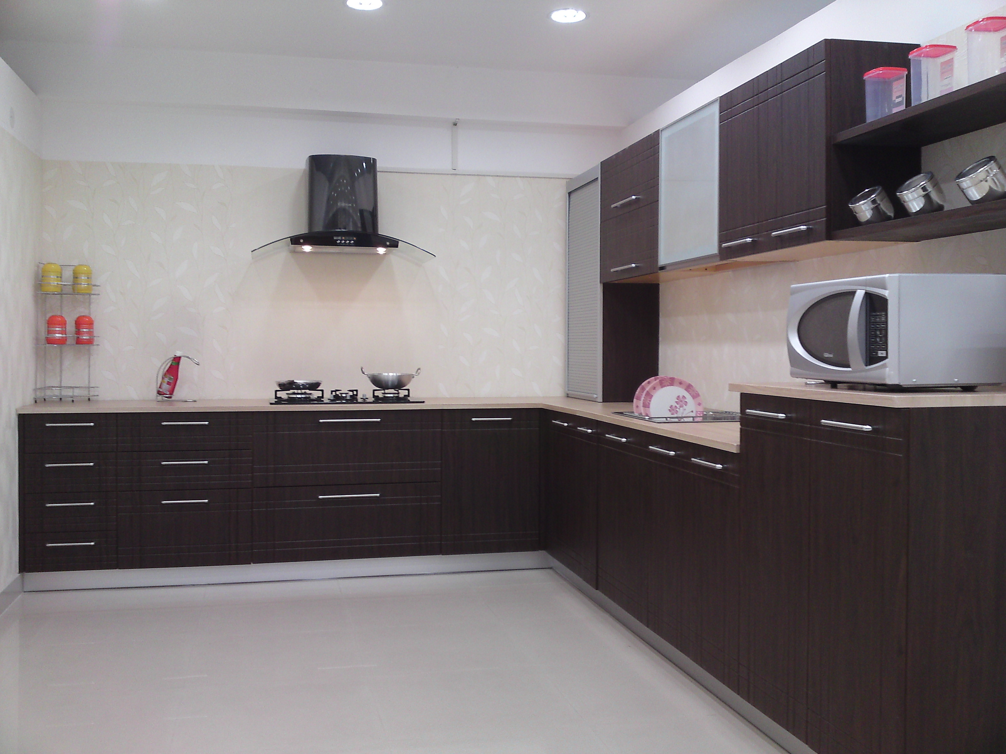 Home spaces intelligent solutions modular kitchens in for Sample modular kitchen designs